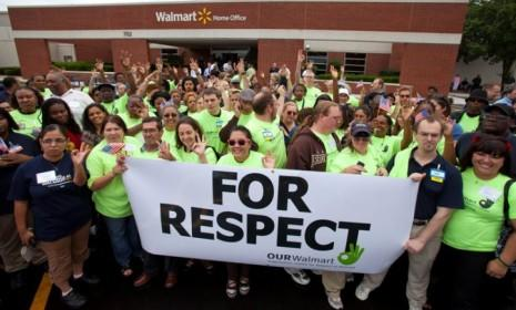 Members of OUR Walmart march to the superstore's headquarters in 2011 to present their unified demands: The Walmart employee group is organizing a strike on Black Friday.