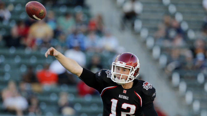 National team quarterback Jeffrey Tuel (12) of Washington State throws a pass during the NFLPA Collegiate Bowl on Saturday, Jan. 19, 2013 in Carson, Calif. (Ric Tapia/AP Images for NFLPA)
