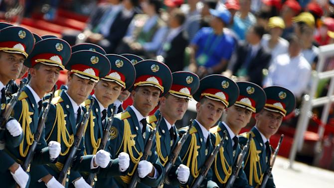 Tajikistan's soldiers march during the military parade marking the 70th anniversary of the end of World War Two, in Beijing