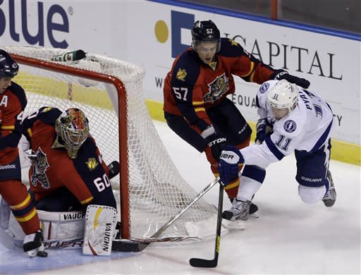 Pouliot lifts Lightning past Panthers in OT