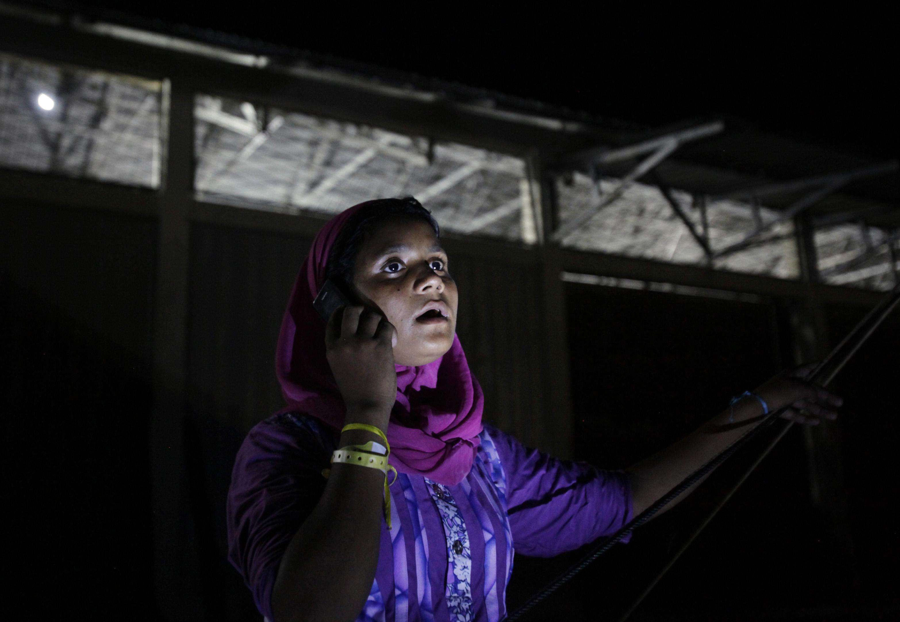 AP PHOTOS: Safe on land, migrants eager to phone home
