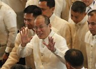 Philippine President Benigno Aquino gestures while being surrounded by presidential security officials after delivering his fourth State of the Nation Address (SONA) at the House of Representatives in Quezon City, Metro Manila July 22, 2013. REUTERS/Romeo Ranoco/Files