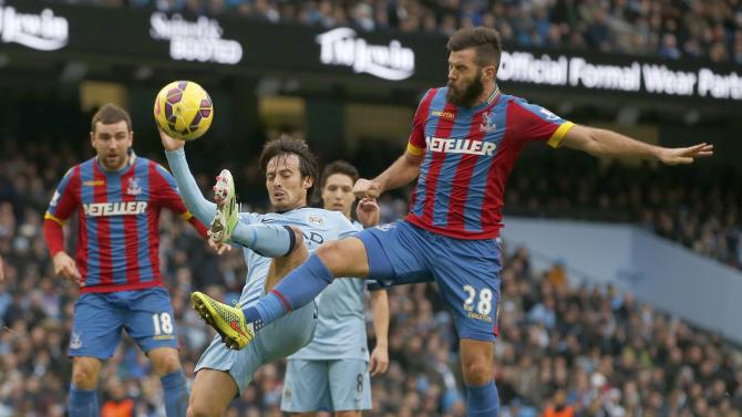 Manchester City's David Silva challenges Crystal Palace's Joe Ledley during their English Premier League soccer match at the Etihad Stadium in Manchester