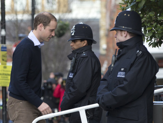Britain's Prince William arrives at the King Edward VII hospital to visit his wife the Duchess of Cambridge who has been admitted to hospital suffering from severe morning sickness, in central London, Wednesday, Dec. 5, 2012. Prince William and his wife Kate are expecting their first child, and the Duchess of Cambridge is suffering from a severe form of morning sickness in the early stages of her pregnancy. (AP Photo/Alastair Grant)