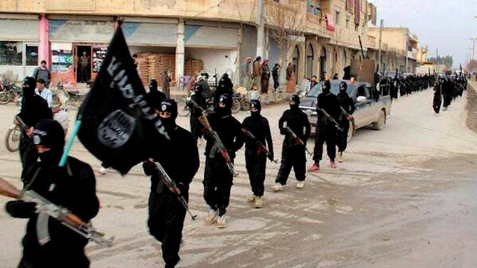 FILE - This undated file image posted on a militant website on Tuesday, Jan. 14, 2014 shows fighters from the al-Qaida-linked Islamic State of Iraq and the Levant (ISIL) marching in Raqqa, Syria. The Islamic State was originally al-Qaida's branch in Iraq, but it used Syria's civil war to vault into something more powerful. It defied orders from al-Qaida's central command and expanded its operations into Syria, ostensibly to fight to topple Assad. But it has turned mainly to conquering territory for itself, often battling other rebels who stand in the way. (AP Photo/Militant Website, File)