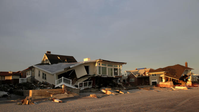 Homes destroyed by Superstrom Sandy front the beach in the Rockaways section of New York, Wednesday, Jan. 2, 2013.  House Speaker John Boehner's decision to cancel an expected vote Tuesday night on aid for Superstorm Sandy victims outraged lawmakers from New York, New Jersey and elsewhere, including many in his own party.   (AP Photo/Seth Wenig)