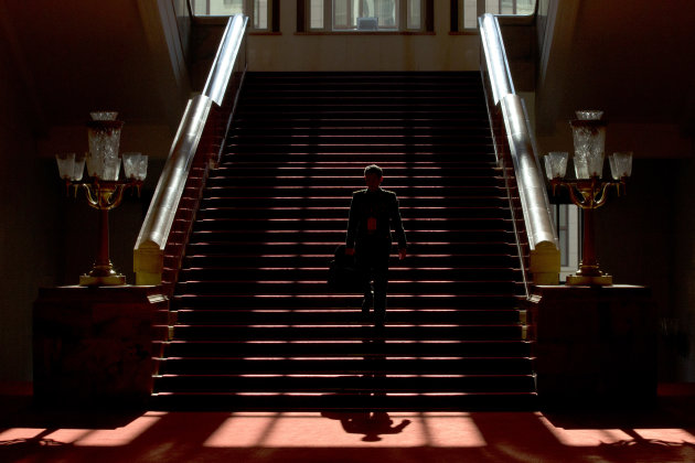 A People's Liberation Army officer walks down stairs with a document holder inside the Great Hall of the People where the closing ceremony for the 18th Communist Party Congress is held in Beijing Wedn