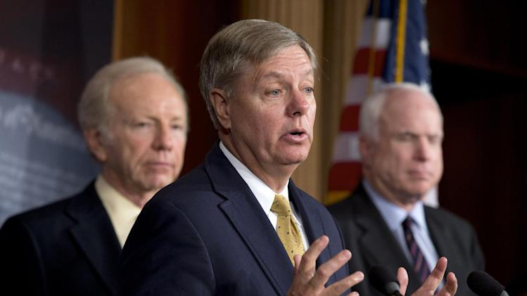 Sen. Lindsey Graham, R-S.C., center, accompanied by Sen. Joseph Lieberman, I-Conn., left, and Sen. John McCain, R-Ariz., gestures during a news conference on Capitol Hill in Washington, Thursday, Dec. 6, 2012, to discuss Syria.  (AP Photo/Jacquelyn Martin)