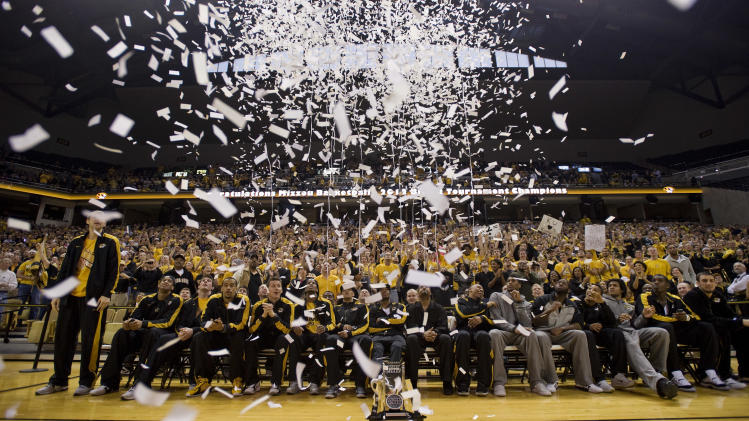 Confetti shoots over the Missouri basketball team as they watch their team get picked as a #2 seed in the West Region during their NCAA Tournament selection party in Mizzou Arena Sunday, March 11, 2012, in Columbia, Mo. (AP Photo/L.G. Patterson)