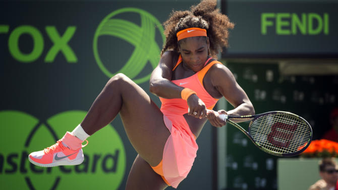 Serena Williams celebrates after winning a point against Sabine Lisicki, of Germany, during their match at the Miami Open tennis tournament in Key Biscayne, Fla., Wednesday, April 1, 2015. Williams won 7-6(4), 1-6, 6-3. (AP Photo/J Pat Carter)