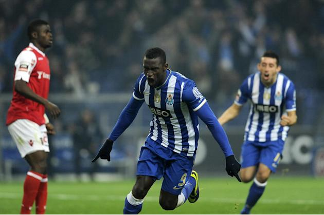 FC Porto's Jackson Martinez, from Colombia, center, celebrates with Hector Herrera from Mexico, rear, after scoring the opening goal against Sporting Braga in a Portuguese League soccer match at t