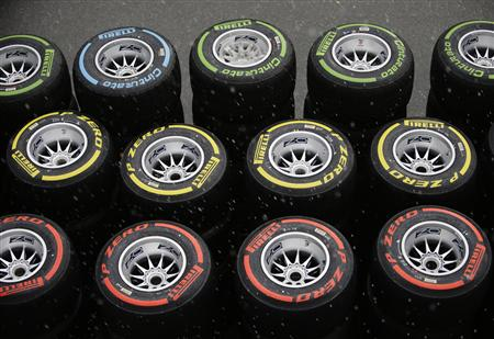 Pirelli tyres are seen in the paddock as it rains ahead of the first practice session of the Singapore F1 Grand Prix