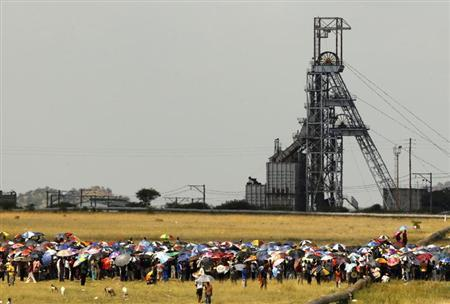 South Africa minister warns on economy as mines face strike threat