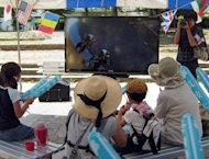 Evacuated Fukushima residents are seen watching Japanese track cyclist Kazunari Watanabe competing at the London Olympics on a television screen during a public viewing event at Tsukuba, Ibaraki prefecture, on August 3. Watanabe is from the small town of Futaba on Japan's tsunami affected coast