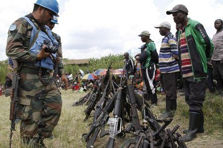 United Nations peace keepers record details of weapons recovered from the Democratic Forces for the Liberation of Rwanda (FDLR) militants after their surrender in Kateku