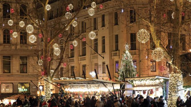 People visit the Budapest Christmas Fair at Vorosmarty square in downtown Budapest