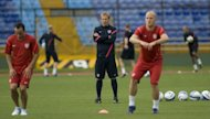 US coach Jurgen Klinsmann (C) during a team training session in Guatemala on June 11. Klinsmann says his team must improve for Tuesday's World Cup 2014 qualifying match at Guatemala despite a triumphant start to their quest for a trip to Brazil in two years