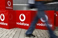 An Indian government panel has called on the government to scrap a law to tax past merger deals, in a move that could spare British phone giant Vodafone a multi-billion-dollar tax bill