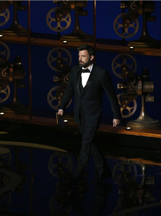 Presenter Ben Affleck announces the Oscar for best documentary at the 85th Academy Awards in Hollywood