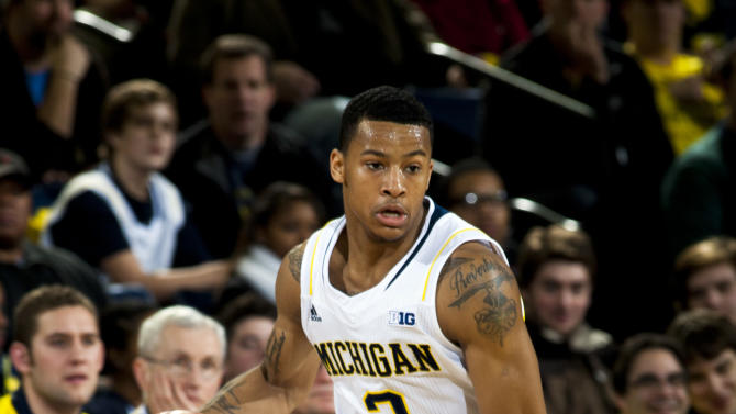FILE - Michigan guard Trey Burke (3) dribbles in the first half of an NCAA college basketball game against Eastern Michigan, in this Dec. 20, 2012 file photo taken at Crisler Center in Ann Arbor, Mich. As the college basketball season nears its midpoint, the player of year honor appears to be up for grabs with roughly two dozen players who could be considered the best in the country. Trey Burke is among a Pick 6 of players having outstanding seasons so far.(AP Photo/Tony Ding, File)
