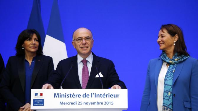 French Interior Minister Bernard Cazeneuve, Environment Minister Segolene Royal and Mayor of Paris Anne Hidalgo attend a news conference on COP21 World Climate Summit security, following the Paris attacks, at the Interior Ministry in Paris