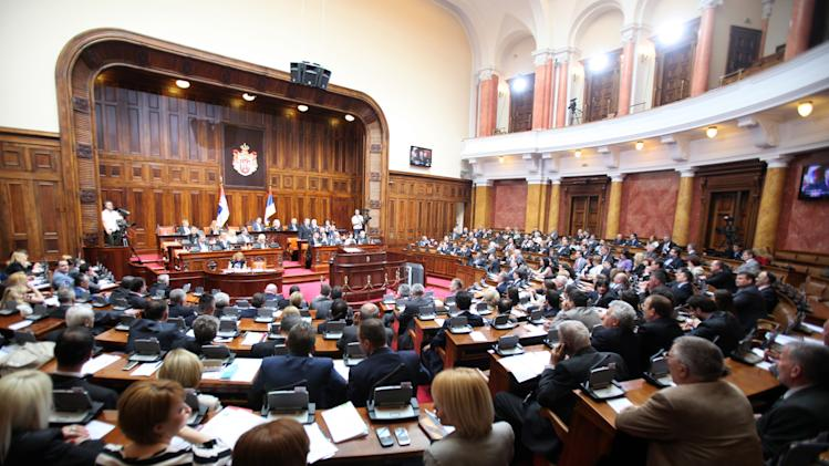 """Serbian Prime Minister Ivica Dacic addresses a parliament session in Belgrade, Serbia, Friday, April 26, 2013. Serbia's prime minister is urging parliament's support for an agreement to normalize relations with breakaway Kosovo, telling lawmakers that rejection of the EU-brokered deal would have turned the country into """"Europe's North Korea."""" (AP Photo/Darko Vojinovic)"""