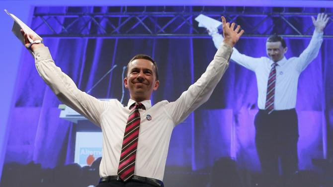 Lucke founder and co-chairman of AFD party receives applause during his key-note speech at party congress in Essen