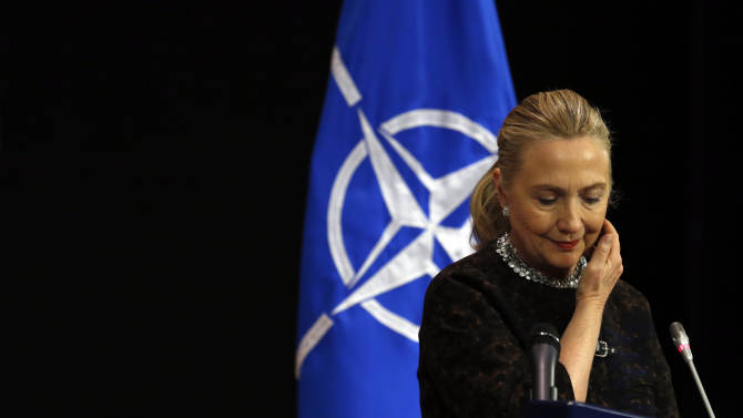 Secretary of  State Hillary Rodham Clinton pauses during a news conference at NATO headquarters in Brussels, Wednesday, Dec. 5, 2012.   (AP Photo/Kevin Lamarque, Pool)