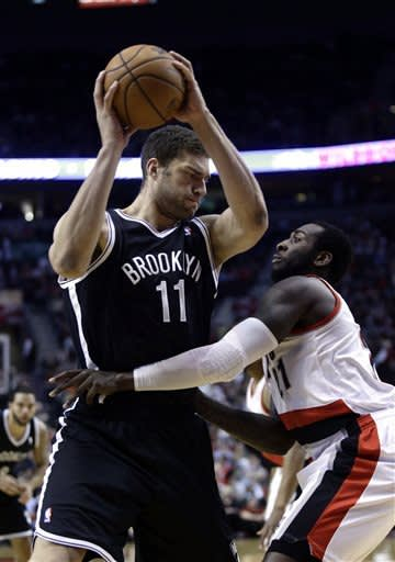 Evans (22 points, 26 rebounds) leads Nets
