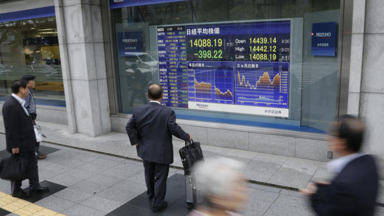 Markets steady despite big slide in Nikkei