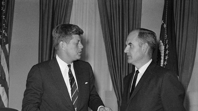 FILE - In this Jan. 24, 1961 file photo, President John F Kennedy talks, with George McGovern, right, a special presidential assistant who also is director of the Food for Peace program, at the White House in Washington. A family spokesman said he passed away peacefully, surrounded by family and life-long friends early Sunday morning Oct. 21, 2012. He was 90. (AP Photo, File)
