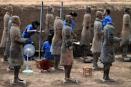 This picture taken on June 9, shows Chinese archaeologists at work in the extended excavation site at the Terracotta Warriors and Horses Museum in Xian. Chinese archaeologists have unearthed 110 new terracotta warriors that laid buried for centuries, part of the famed army built to guard the tomb of China's first emperor