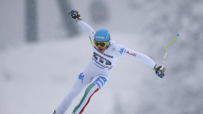 Italy's Christof Innerhofer speeds down the course on his way to clock the fastest time during a training session for an alpine ski, men's World Cup downhill, in Garmisch Partenkirchen, Germany, Friday, Feb. 22 , 2013. (AP Photo/Shinichiro Tanaka)