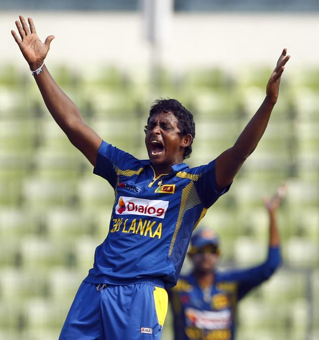 Sri Lankan cricket player Ajantha Mendis appeals successfully for the dismissal of Bangladesh's Shamsur Rahman during the Asia Cup one-day international cricket tournament in Dhaka, Bangladesh, Thursd