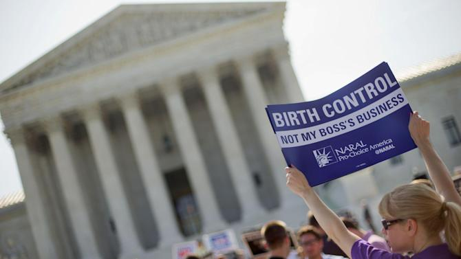 This June 30, 2014 file photo shows a demonstrator holding up a sign outside the Supreme Court in Washington on the day the court decided in the Hobby Lobby case to relieve businesses with religious objections of their obligation to pay for women's contraceptives among a range of preventive services the new health law calls for in their health plans. How much distance from an immoral act is enough is the difficult question behind the next legal dispute over religion, birth control and the new health law that is likely to be resolved by the Supreme Court. The issue in more than four dozen lawsuits from faith-affiliated charities, colleges and hospitals who oppose some or all contraception as immoral is how far the Obama administration must go to accommodate them. (AP Photo/Pablo Martinez Monsivais, File)
