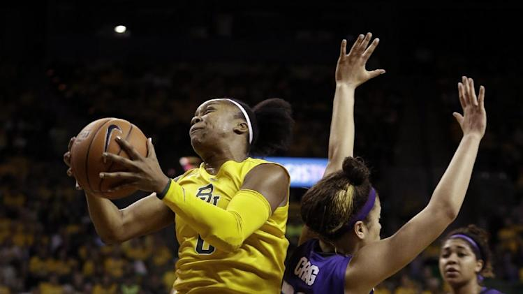 Baylor guard Odyssey Sims (0) shoots past Kansas State guard Brianna Craig (20) during the first half of an NCAA college basketball game Monday, March 4, 2013, in Arlington, Texas. (AP Photo/LM Otero)
