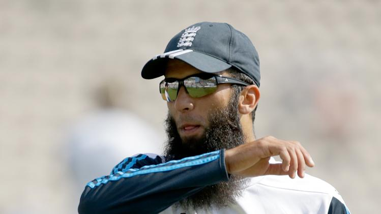 England cricket player Moeen Ali walks off the pitch after taking part in the warm-up before the start of play on the third day of the third cricket test match of the series between England and India at The Ageas Bowl in Southampton, England, Tuesday, July 29, 2014. England allrounder Moeen Ali has been banned from displaying political messages on the field by the International Cricket Council, after wearing wristbands supporting Palestinians during the third test.(AP Photo/Matt Dunham)