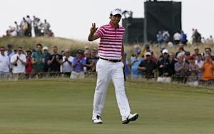 Matteo Manassero of Italy reacts after his birdie putt during the second round of the British Open Championship at the Royal Liverpool Golf Club in Hoylake