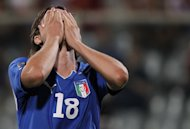 Italian midfielder Riccardo Montolivo reacts after missing to score against Slovenia during a group C, EURO 2012 qualifying soccer match, at the Artemio Franchi stadium in Florence, Italy, Tuesday, Sept. 6, 2011. (AP Photo/Fabrizio Giovannozzi)