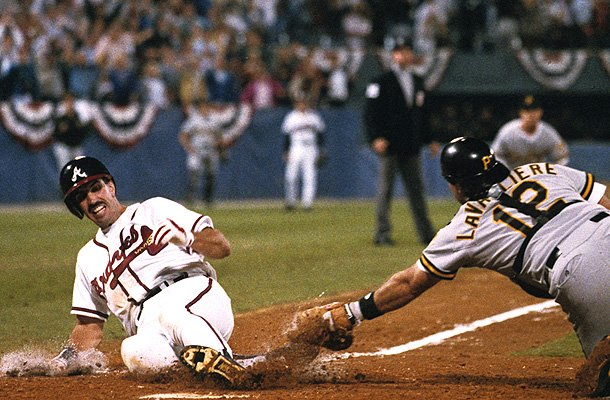 Sid Bream slides in ahead of Mike LaVallier&amp;#39;s tag to win Game 7 of the 1992 NLCS. (Getty Images)