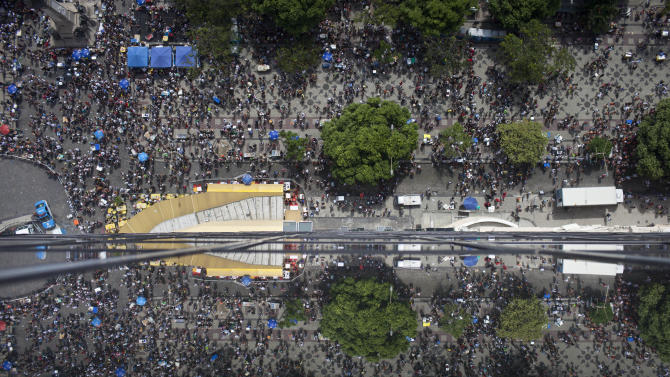 """Revelers pack the streets during the """"Cordao da Bola Preta"""" street carnival parade in Rio de Janeiro, Brazil, Saturday, Feb. 9, 2013. According to Rio's tourism office, Rio's street Carnival this year will consist of 492 block parties, attended by an estimated five million Carnival enthusiasts. (AP Photo/Felipe Dana)"""