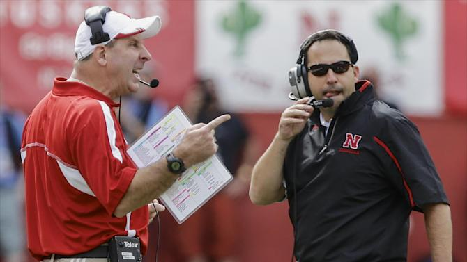 Nebraska head coach Bo Pelini, left, calls instructions with defensive coordinator John Papuchis looking on, in the first half of an NCAA college football game against UCLA in Lincoln, Neb., Saturday, Sept. 14, 2013. UCLA won 41-21. (AP Photo/Nati Harnik)
