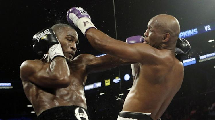 Bernard Hopkins,right, hits Tavoris Cloud, left,  during the fifth round of an IBF Light Heavyweight championship boxing match against Tavoris Cloud at the Barclays Center Saturday, March 9, 2013, in New York. (AP Photo/Frank Franklin II)
