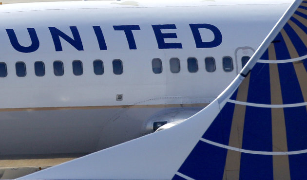 FILE - In this Sept. 13, 2011, file photo, United Continental Airlines jets sit on the tarmac at Cleveland Hopkins Airport in Cleveland. The parent of United Continental Holdings Inc. said Thursday, April 26, 2012, that it lost $448 million in the first quarter as it dealt with higher fuel prices and hiccups in its integration with Continental Airlines. The loss amounted to $1.36 per share_not counting integration costs, it would have lost $286 million, or 87 cents per share. (AP Photo/Amy Sancetta, File)