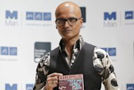"Indian author Jeet Thayil holding his book ""Narcopolis"" in London on October 15, 2012. A debut novel and a work by a Nobel laureate were among five books shortlisted for Asia's most prestigious literary prize on Wednesday, with entries across the region from Turkey to Japan"
