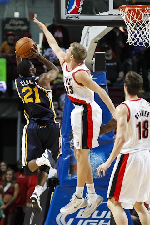 Utah Jazz shooting guard Ian Clark (21) shoots over Portland Trail Blazers small forward E.J. Singler (33) in the second half of a preseason NBA basketball game on Friday, Oct. 11, 2013, in Boise, Ida