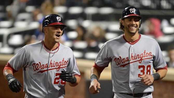 Washington Nationals' Ian Desmond, left, and Michael Morse return to the dugout after Desmond drove in Morse with a two-run home run in the fourth inning of the baseball game against the New York Mets in New York, Monday, Sept. 10, 2012. (AP Photo/Henny Ray Abrams)