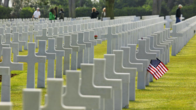 Visitors walk among the 9,387 graves at the Colleville American military cemetery, in Colleville sur Mer, western France, Thursday June 6, 2013, on the day of the commemoration of the 69th anniversary of the D-Day.(AP Photo/Remy de la Mauviniere)