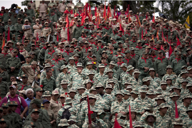 FILE - In this Jan. 10, 2013 file photo, members of Venezuela's Bolivarian militia attend the symbolic inauguration for President Hugo Chavez in Caracas, Venezuela.  Since taking office in 1999, Chave