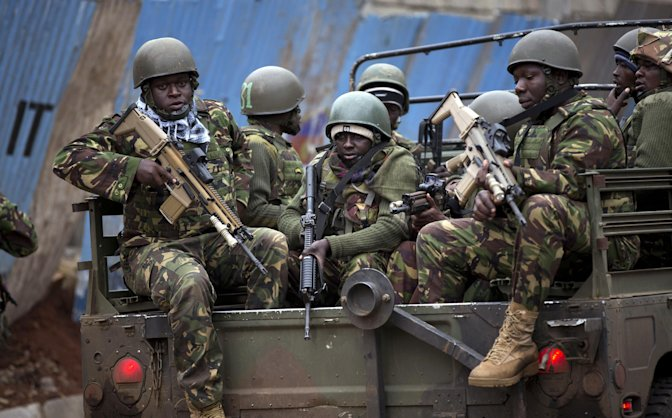 Sunday, Sept. 22, 2013: Nairobi, Kenya_ Trucks of soldiers from the Kenya Defense Forces arrive after dawn outside the Westgate Mall. Kenyan authorities said Islamic extremist attackers remain inside the upscale Kenyan shopping mall, holding an unknown number of hostages, after killing and injuring scores of people in the attack. (AP Photo/Ben Curtis)